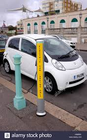 pershow car peugeot car at an electric car charging point on brighton seafront