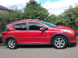peugeot estate cars 2009 peugeot 207 sw outdoor 110 red estate diesel 5 seats in