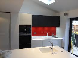 red glass splashback on alno kitchen with corian worktops u0026 miele