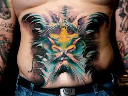 men stomach simple weird monster face tattoo tattooshunter