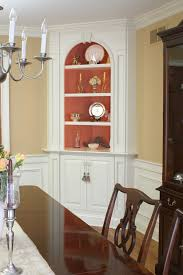 classic dining room with white painted built in corner hutch
