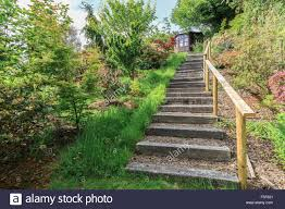 Gardens With Summer Houses - steep steps in garden landscape with summer house stock photo