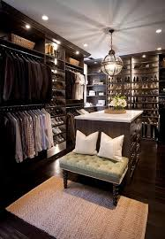 custom walk in closet features dark stained built ins boasting