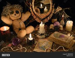 magic ritual with voodoo doll mirror candles and tarot cards