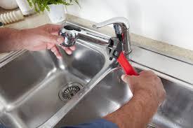 repairing leaky kitchen faucet kitchen magnificent dripping kitchen faucet on repair leaky sink