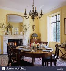 dining room in english townhouse with country style interior stock