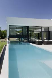 swimming pool stunning split house design with wide glass window