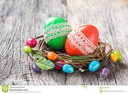 red and green easter eggs decorated with lace in small decorative