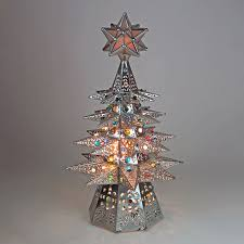 small lighted tin tree with colored marbles