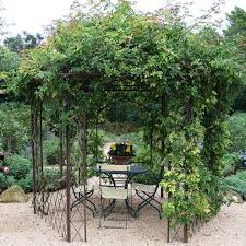 vine covered pergola patio shabby chic style with table