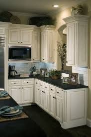 White Kitchen Cabinets With Black Granite The Distressed Look Of These Cabinets Cabinets Pinterest