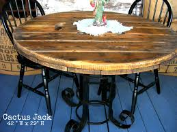 outdoor tables made out of wooden wire spools use the top of a wire spindle or make a circle top out of pallets