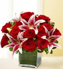 roses and lilies forever yours 18 roses stargazer lilies in worthington oh