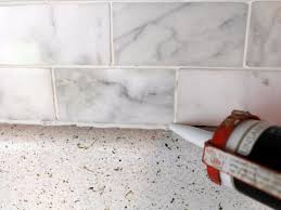 How To Install A Tile Backsplash In Kitchen Fascinating Caulking Kitchen Backsplash Also To Install Marble