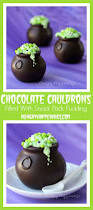 chocolate cauldrons filled with snack pack pudding and magical mix