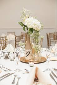 modern table numbers understated michigan wedding at historic barns park painted wine