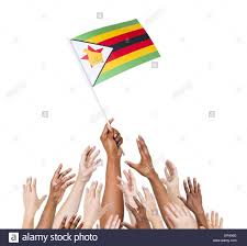 Flag Of Zimbabwe Group Of Multi Ethnic People Reaching For And Holding The Flag Of