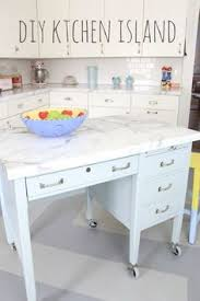 Diy Kitchen Island Diy Kitchen Island From Old Desk Love The Wheels Cover The