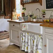 Country Decorating Ideas For Kitchens Eye For Design Decorating With Skirted Kitchen Cabinets And Sinks