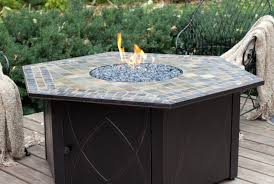 Fire Pit With Glass by Table Glass Surface Table With Fire Pit Over Wooden Floor