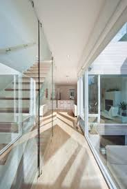 glass wall stairs hintonburg home in ottawa canada