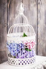 hydrangea flowers in the white birdcage flower decor for the