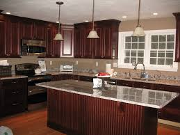 dark cabinets white granite yellow pendant lamps dark countertops