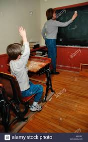 desk for 6 year old p32 188 6 year old boy raises hand at desk as mom erases at stock