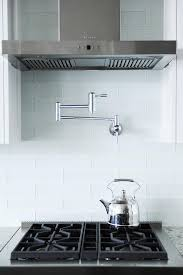 Light Blue Kitchen Backsplash by Blue Glass Kitchen Backsplash Tiles With Swing Arm Pot Filler