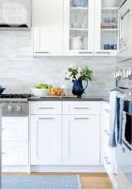 white shaker kitchen cabinets with gray quartz countertops 12 popular hardware ideas for shaker cabinets kitchen