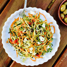 courgette cuisine vegetarian pesto courgette n carrot noodles with feta cheese and olives