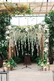 Wedding Arches Decorated With Tulle Green And White Floral Wedding Arch Kiss My Tulle Wedding