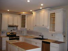 how tall are upper kitchen cabinets 36 upper cabinets with 6 stacked molding 8 foot ceilings dream