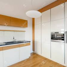 modern white kitchen cabinets wood floor modern white kitchen with stylish wooden floor cupboards and