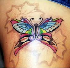 elegant butterfly tattoos enhanced with flower designs cool