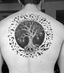 circle tree of with birds flying mens back