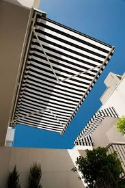 External Awning Blinds The Black And White Awnings Create A Clean Classic Look