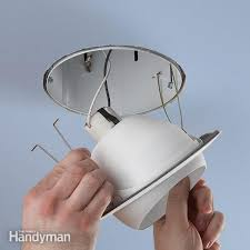 how to replace a recessed can light fixture upgrade a recessed light fixture family handyman