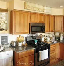 ideas for tops of kitchen cabinets kitchen top of cabinet decor ideas storage on top of kitchen