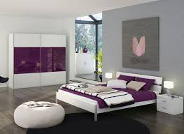 attractive bedroom design with white wall painting glass window