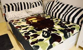 a bathing ape bape coral fleece blanket on the bed camouflage