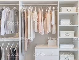 clothes hanging on rail in white wardrobe stock photo 518597694