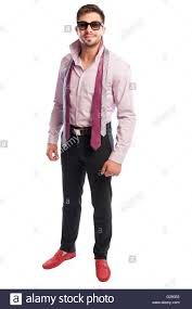 brunet male model with purple shirt black pants red shoes stock