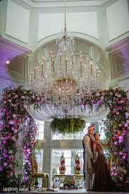 Indian Wedding Mandap Rental Floral Mandap Accented By A Grand Chandelier Perfect Modern