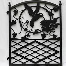 ornamental wrought iron garden fence entrance gate hummingbird