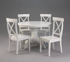 round white wooden dining table with chairs on the f gray floor