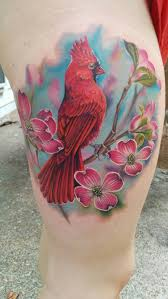 pink flowers and cardinal tattoo on thigh