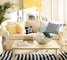 coastal summer decorating idea with beige sofa and striped area