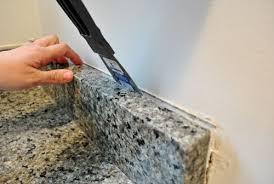 how to caulk a sink backsplash removing granite backsplash 0 prying off representation the side
