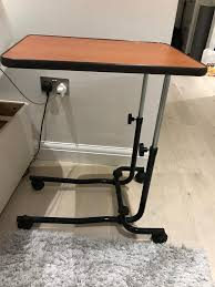 bed table on wheels wheeled over bed table on wheels barely used wooden adjustable